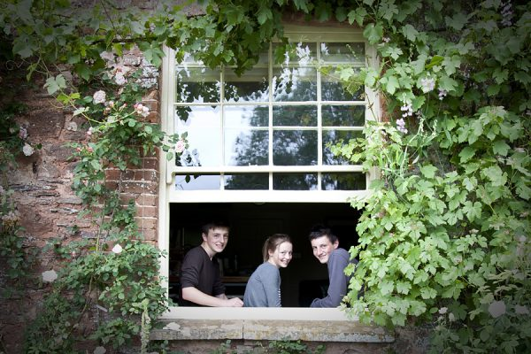 Young adults in a window surrounds by Ivy